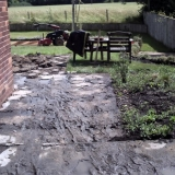 Start of project old slap removal. Shows garden was on several different levels.