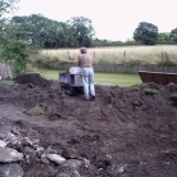 Top soil imported to raise lawn area.